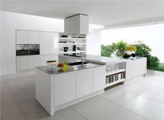 White Stain Wall comes with White Ceramics Floor and White Stain Wooden Kitchen Island