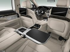 Spacious: Top of the range models can include an 'Executive Lounge' (pictured) which BMW says 'redefines personal well-being in a luxury car.' In practice this means that the back seats are spacious and packed with gadgets for discerning businessmen