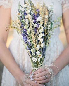 Dried flowers make beautiful wedding bouquets and decor, and the best part is that they can be made in advance to take the stress of the wedding day away, and then they can be kept and displayed in the couple's home as a beautiful memory of their special wedding day.  This bouquet is made with Dried Wheat, Dried Ammobium, and Dried Dark Blue Larkspur.  All of these items are available in our store so you can create a bouquet!  #driedflowers #driedplants #flow