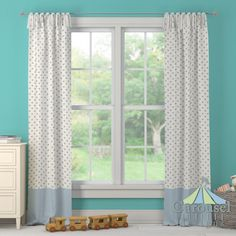 Custom drapes in White and Taupe Polka Dot, Solid Lake Blue.  Created using the Drape Designer by Carousel Designs