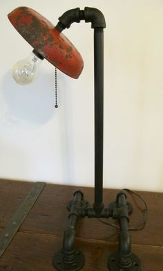Vintage Fire Bell, Industrial Steampunk Table Lamp, Black Pipe Fittings with Flange Feet Base. $110.00, via Etsy.