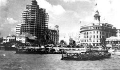 1953-54- View of Ocean building (right) and Asia Insurance building (left) under construction along the Singapore waterfront