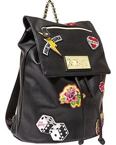 The mix of embroidered patches against the neon backpack works ...
