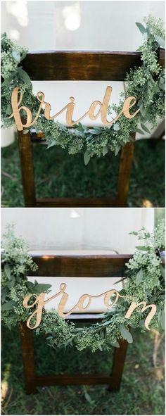 Chair décor, sweetheart table, seeded eucalyptus, garland, gold bride & groom sign // Kristine Marie Photography
