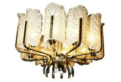 1950s Austrian Icarus leaf chandelier with a polished nickel frame that supports 10 large frosted glass leaves with each leaf concealing a light source.  1,099.00