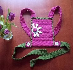 I am baby-wearing mother and my daughter loves it! She wants me to crochet similar carrier for her little doll.