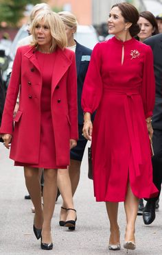 (R-L) Crown Princess Mary of Denmark and French First Lady Brigitte Macron both opt for scarlet as they take part in a wreath-laying cerem. Princesa Mary, French President Wife, French First Lady, White Louis Vuitton, Style Royal, Brigitte Macron, First Ladies, Estilo Real, Column Dress