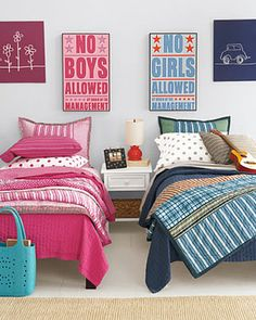 Such a great way to separate a shared room...cute! love the wall art ;)