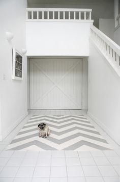 I am a sucker for a nice chevron rug.  I also have a thing for grey stuff. And even though this little dog looks a little tired, he is really making it work!