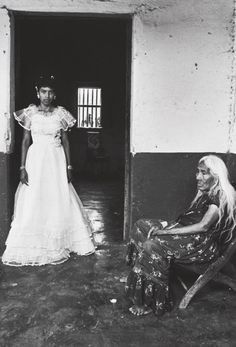 Graciela Iturbide, Quince Años, Juchitán, 1986 [girl in white dress, old woman sitting in chair]