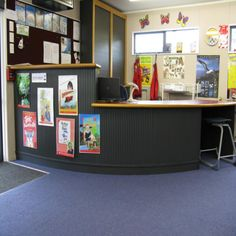 Desk Colour.  Example of a two tier level school library issue desk | Services to Schools