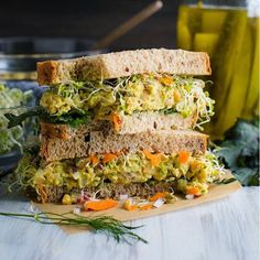 Smashed chickpea salad sandwich from @vanillaandbean!  Ingredients  For the Salad: 1 Can Chickpeas, drained and rinsed (aka Garbanzo) (425g)  1/4 C + 1/2 Tbs Dill Pickles, finely chopped (54g )  1/4 C Purple Onion, finely chopped (about 1/2 an onion) (36g)  2 Tbs Just Mayo or Vegenaise (28g)  2 1/2 tsp Stone Ground Mustard (15g)  1 1/2 tsp Apple Cider Vinegar (6g)  1/4 + 1/8 tsp Sea Salt (2g)  2 tsp Dill Weed, fresh-chopped  1/8 tsp Turmeric (optional for color and health!) 8-10 grinds of…