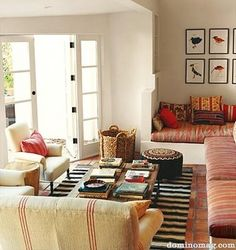 love the mix of patterns & colors... and, of course, the windowseat!