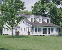Light-Filled Cape Cod - A row of windows on the back of this Cape Cod-style home allows for scenic views of the backyard and lots of natural light inside.