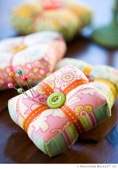 I love pin cushions and I love Heather Bailey fabric.  What a beautiful combination!