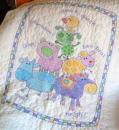 Cross stitch baby blanket I made for my granddaughter.  This was a Dimensions kit.