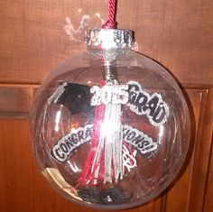 DIY Graduation Christmas Ornament; CLASS OF CHRISTMAS ORNAMENT   I made my daughter with her mini keychain tassle.