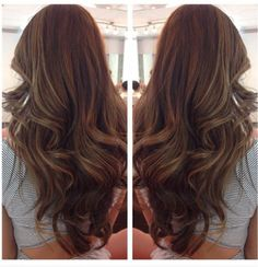 Loose curls keep you looking glam as a wedding guest, yet not over shadowing the bride.