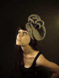 6fdec7e2 Avant Garde Grey Felt Hat with White Accents and Vintage Celluloid Button.  $130.00, via Etsy.