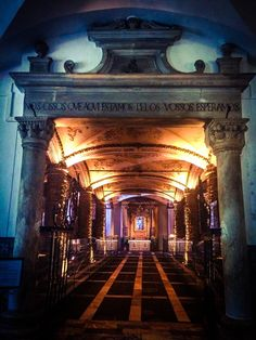 """Chapel of Bones, Évora, Portugal - Entrance to Chapel of the Bones,...""""Our bones that are here wait for yours!"""" (Jennifer Hott-Greenway)"""