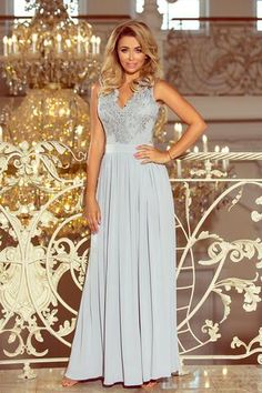 Silver long maxi dress with embroidered neckline. The dress beautifully exposes the neckline and back. The numoco brand.Maxi lace dress - silverThe dimensions are . Polish Clothing, Prom Dresses, Formal Dresses, Wedding Dresses, Silver Gown, Floor Length Dresses, Modern Outfits, Silver Color, Lace Dress