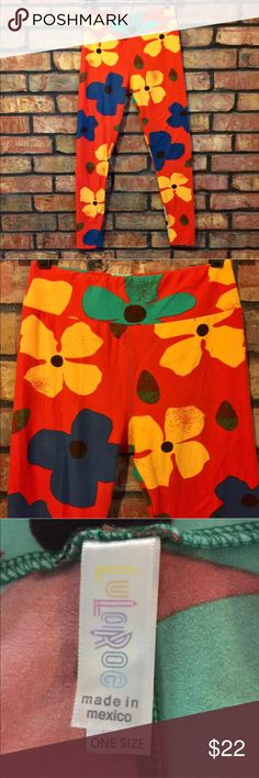"LuLaRoe One Size Retro Large Floral Print Leggings *Please Read Full Description and View All Pictures  Size: One Size (see measurements below)  Background is a Reddish Orange color  Gently used. No rips, stains, tears, or pilling. Smoke free home.  Measurements are taken with garment laying flat:  Waist: 12""  Inseam: 26"" LuLaRoe Pants Leggings"