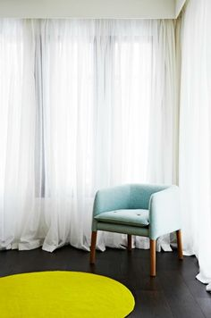 Love the white sheer curtains in Bec Judd's house.