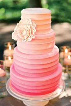 LESLIE & JEFFREY IN NAPA VALLEY, CA  Inspired by the pleating on the bride's Vera Wang gown, the ombré wedding cake resembled layer upon layer of ribbon in gradations of the wedding color. The wow accent: a sugar peony.