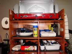 cool wooden storage box for car camping kitchen. has drop down door with cutting board built in. No plans, but easy to DIY