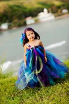 Peacock coloured #FlowerGirl dress with matching flower in her hair