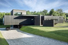 Located in Kent, the Black House, designed by AR Design Studio, was inspired by both historic and modern buildings in the area.