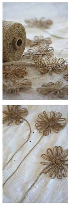 Daisies made with hemp twine and I see crochet stitches holding them together.  Seek out a pattern ....  gift wrap, embellishments, applique