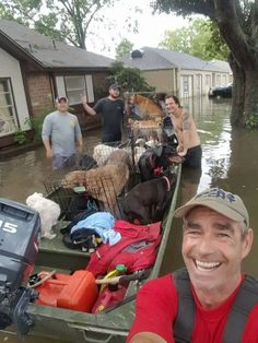 21 helpless animals squeezed onto rescue boat Hurricane Harvey. True heroes!
