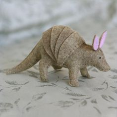 I just want to make some toys. This one looks so cute and fun to make, and you could do your own patterns to make your own menagerie.