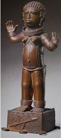 Africa | Figure of a woman from the Benin Kingdom, Nigeria | 17th - 18th century | Brass