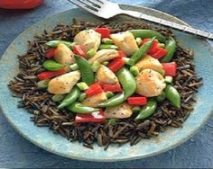 Chicken-Wild Rice Skillet-This is a delicious recipe for a weeknight meal. It as a low calories, low fat, low sodium, low carbohydrates, WeightWatchers (7) PointsPlus recipe. Ingredients include, bell peppers, sugar snap peas, garlic, green onions and chicken served over wild rice. Makes 4 servings.