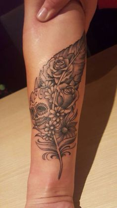 My new tattoo. Skull and flowers in a feather