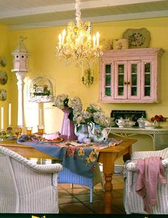 Love the pink cabinet and the yellow walls and everything else in the room too!