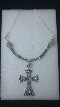 Titanium Viking Knit necklace with silver spiral end caps, clear Czech glass beads, and a studded cross pendant.