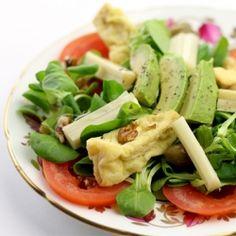 Paesano's in San Antonio serves a similar salad:::  Avocado and Heart of Palm Salad.