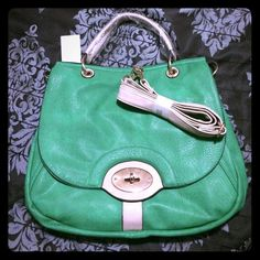"""Green & Tan Handbag Green handbag with tan and goldtone accents. Features turn-lock, neon green interior with tons of pockets and space! This bag may look small but it would hold a lot! I tried to capture this in the second pic but I didn't do a good job  Comes with removable, adjustable matching shoulder strap. Measures approx. 12"""" tall 14"""" across. Brand new/unused. Price firm. Bags"""