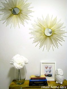 Diy Sunburst Mirror {Tutorial}  Mirror ($1 @dollar tree) Bamboo Skewers ($2) Cardboard (free) Spray Paint ($5) Hot Glue Gorilla Glue Ring Hangers