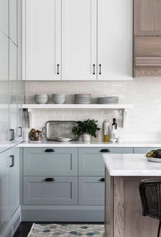 Soft blue gray kitchen cabinets are so stunning and love the mix of painted cabinets with wood cabinets as well - Kitchen Ideas Blue Gray Kitchen Cabinets, Kitchen Cabinets Decor, Cabinet Decor, Painting Kitchen Cabinets, Wood Cabinets, Cabinet Makeover, Cabinet Design, White Cabinets, Cabinet Ideas