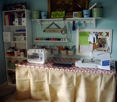 Modge Podge cheap folding table with wrapping paper and staple fabric skirt for decorative crafting station.