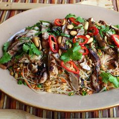 Grilled chicken thighs top this main dish salad that showcases the spicy and sweet flavors of Thai food. Yogurt Marinated Chicken, Grilled Chicken Thighs, Asian Pasta Salads, Pasta Salad Recipes, Asian Recipes, Ethnic Recipes, Oriental Recipes, Japanese Recipes, Spicy Rice