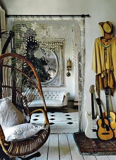Love the doorway treatment and of course the hanging chair...