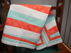 Crib quilt. Coral and turquoise.