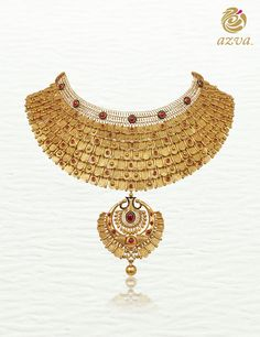 Scalloped showstopper in textured gold and red stones. #Goldjewellery #luxury #style