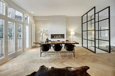 Eames chairs, fishbone flooring, industrial windows