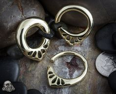 Body Art Forms, solid brass lotus ear weights. I want these so bad!